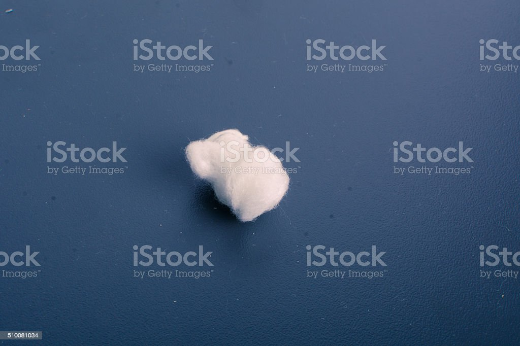 Cotton white ball against a dark background stock photo