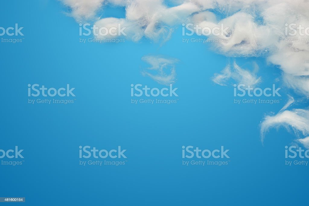 cotton wool clouds over blue. stock photo