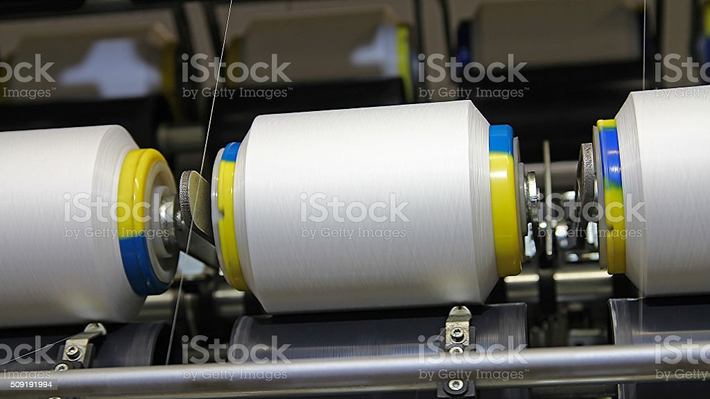 Cotton Yarn Production in a Textile Mill stock photo