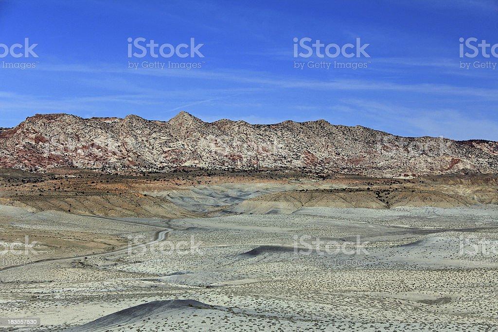 Cottonwood Canyon Road in grey desert stock photo