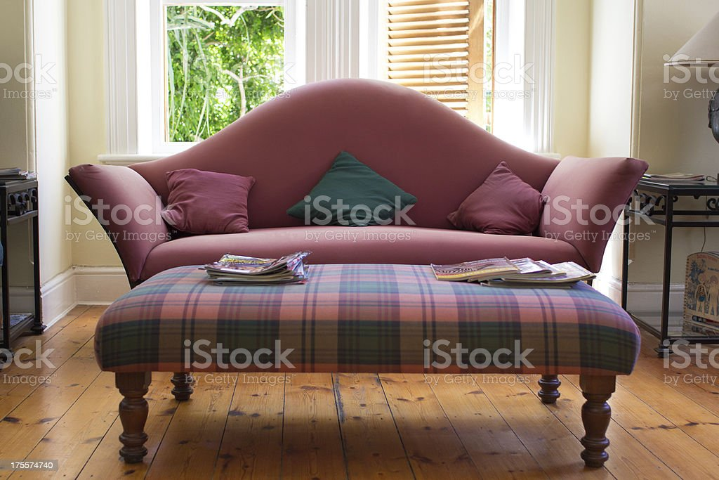 Couch and side table in waiting room royalty-free stock photo
