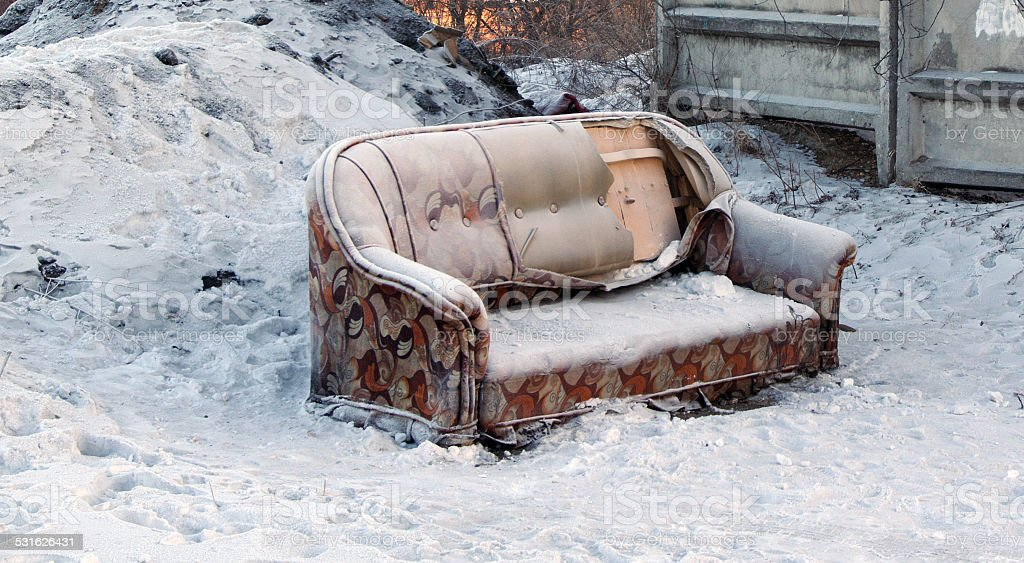 Couch in snow stock photo