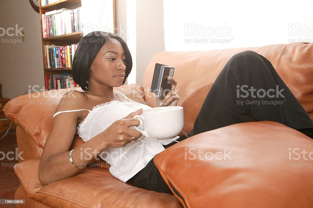 Couch latte and PDA royalty-free stock photo