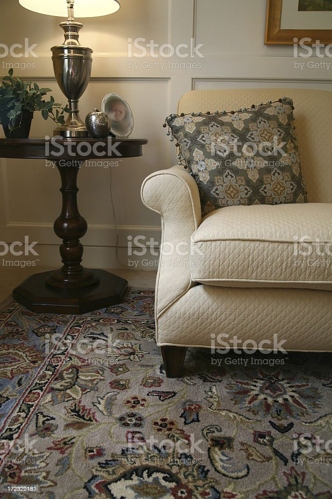 Couch with Embroidered Pillow royalty-free stock photo
