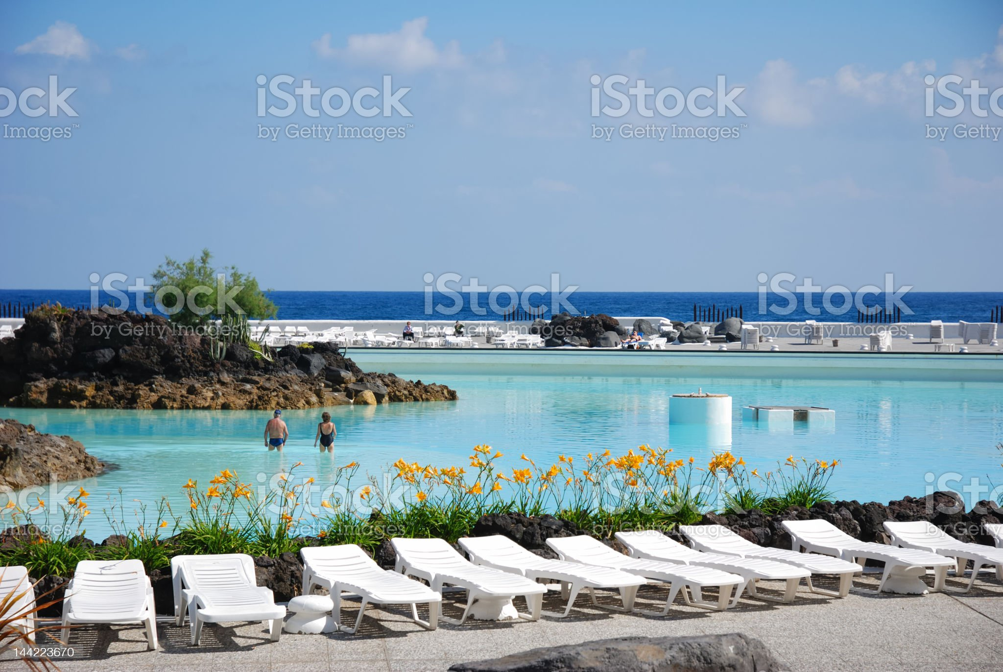 couches at swimming pool royalty-free stock photo
