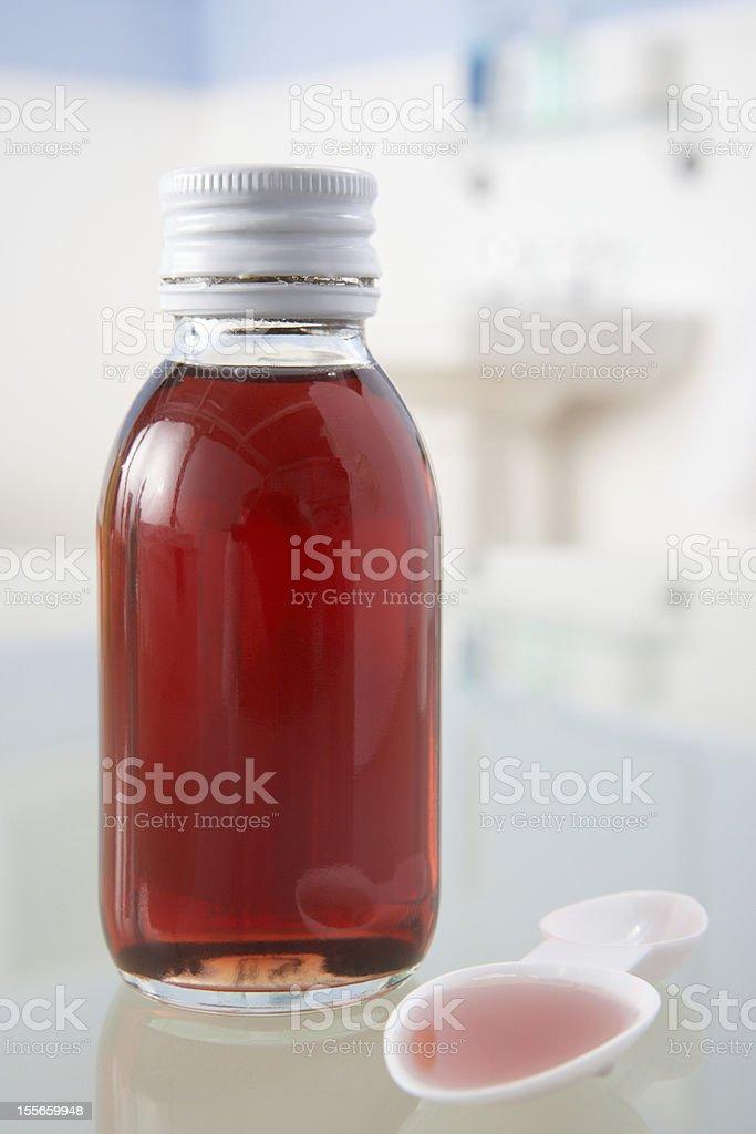 Cough medicine on bathroom shelf stock photo