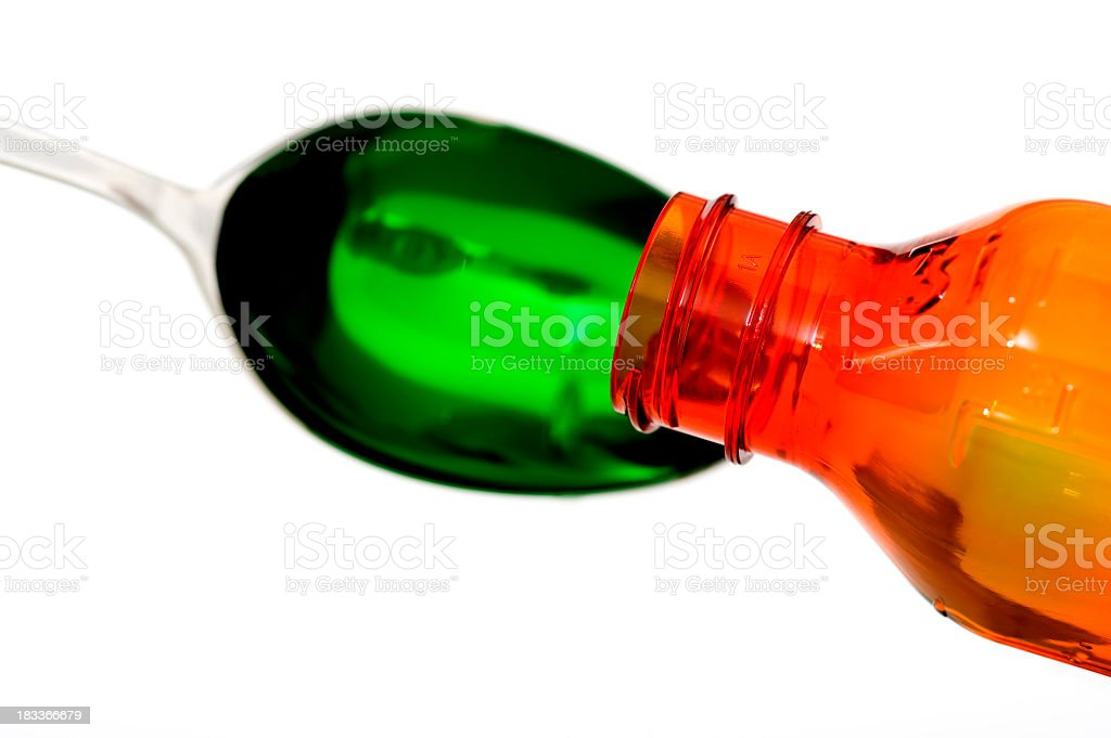 Cough medicine pouring into spoon royalty-free stock photo