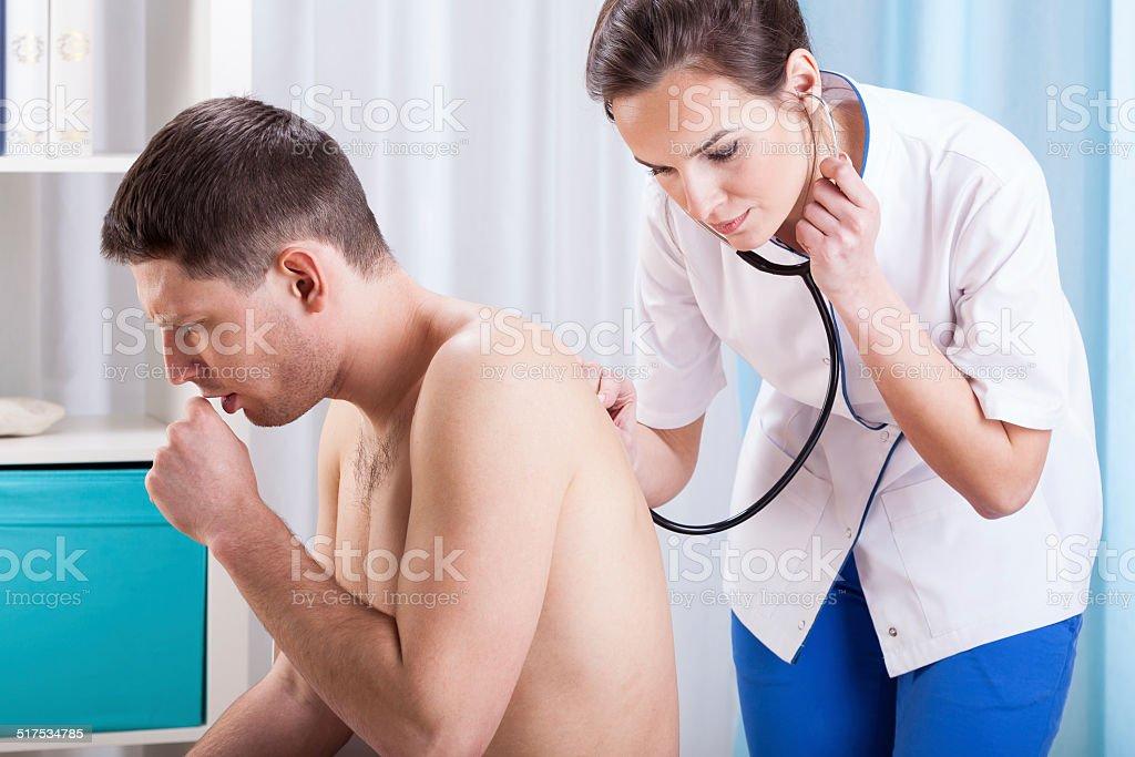 Coughing man having examination stock photo