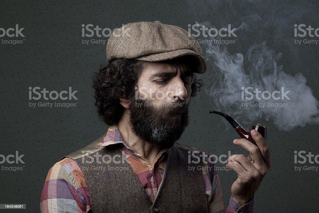 Coughing man smoking pipe stock photo