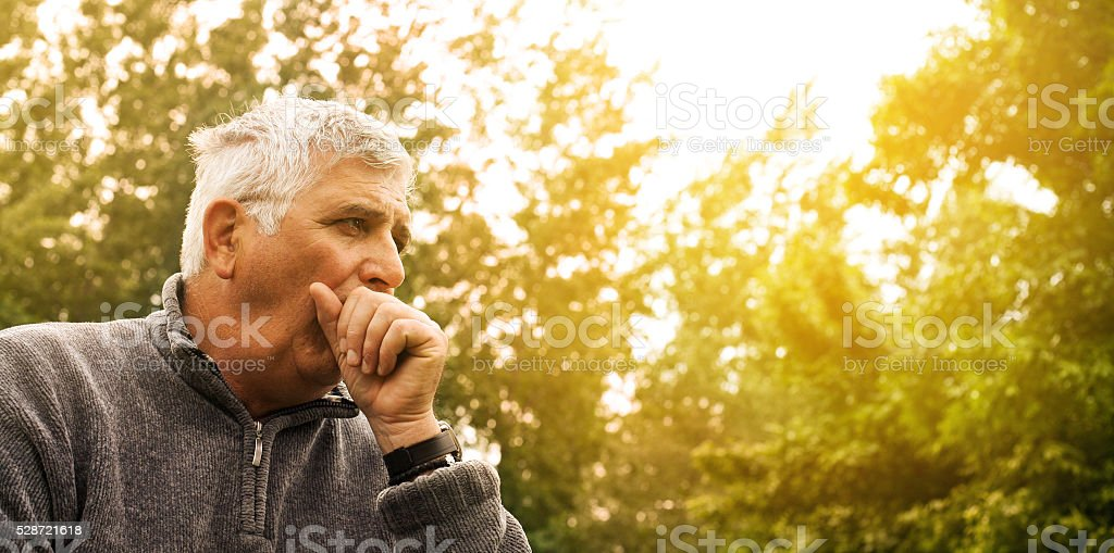 Coughing senior man. stock photo
