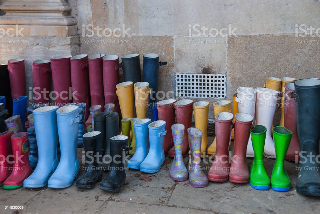 Coulourful Muddy Wellington Boots stock photo