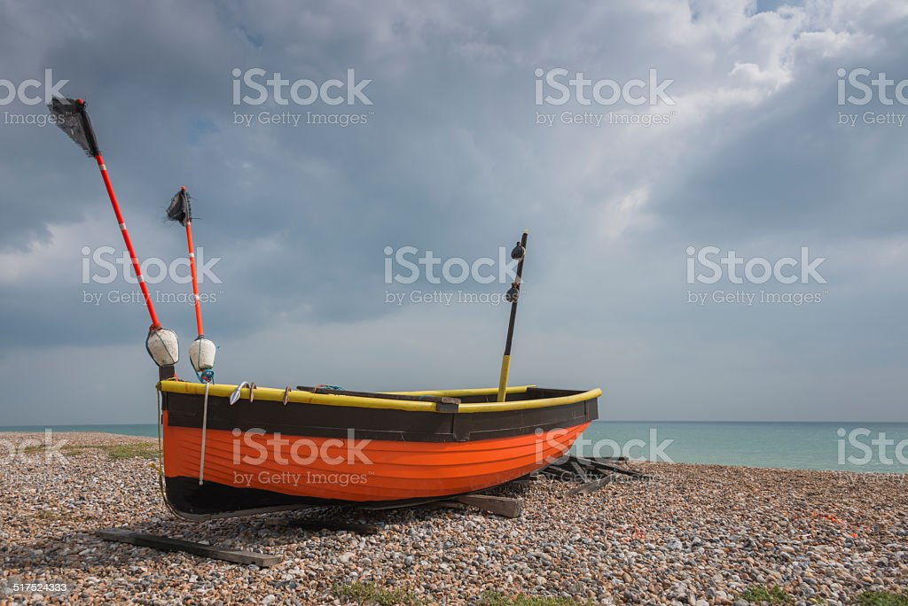 Coulourful Small Wooden Fishing Boat on the Beach stock photo