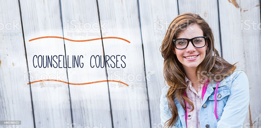Counselling courses against pretty woman smiling at camera stock photo