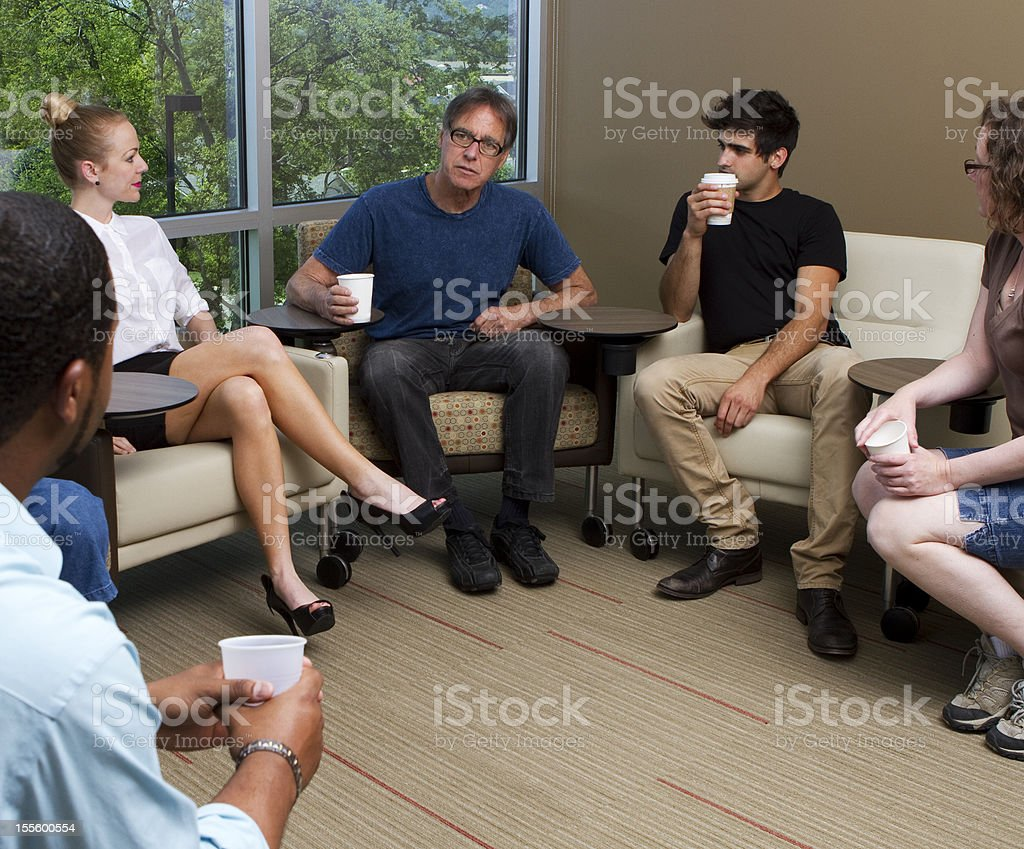 Counselor Assisting With Group Therapy royalty-free stock photo