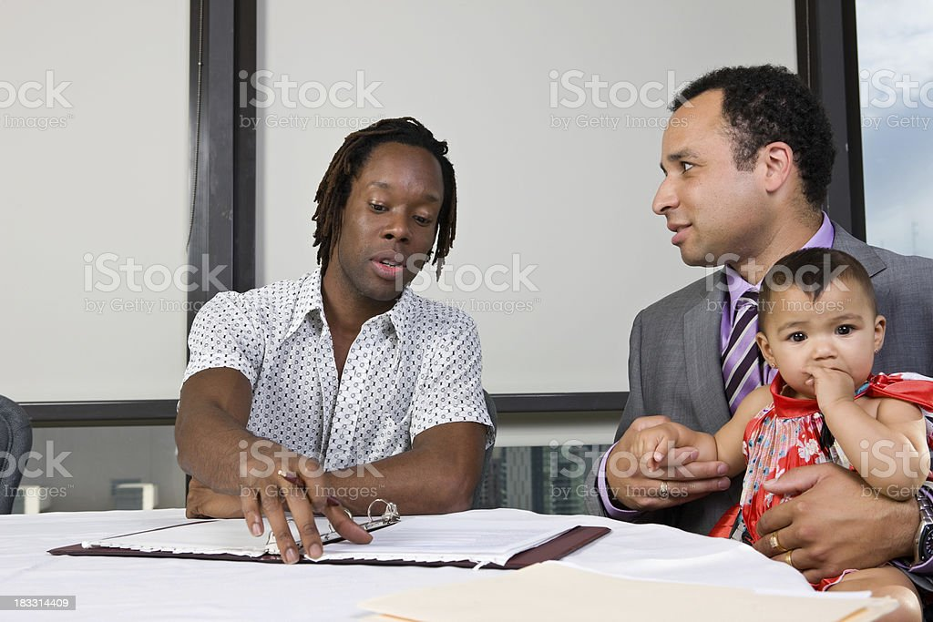 Counselor Discusses College With Father and Child stock photo