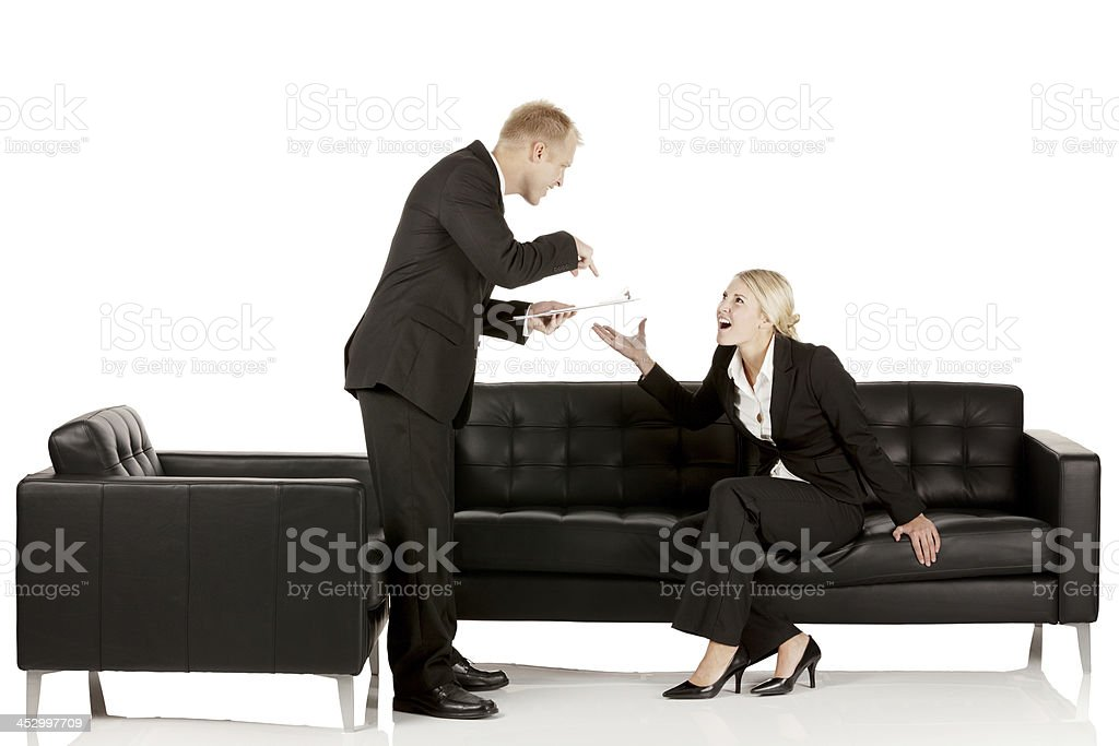 Counselor doing interview of a businesswoman royalty-free stock photo