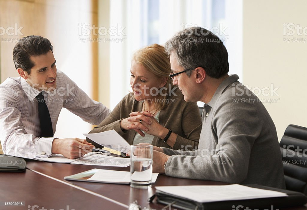Counselor going over papers with older couple royalty-free stock photo