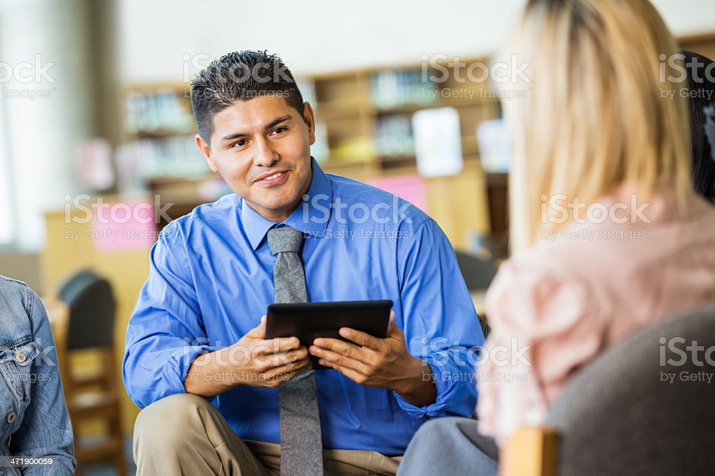 Counselor listening during group therapy session stock photo