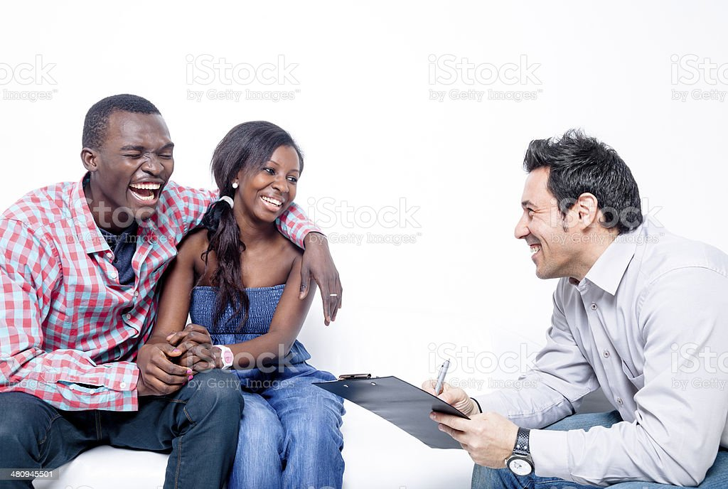 Counselor with black couple stock photo