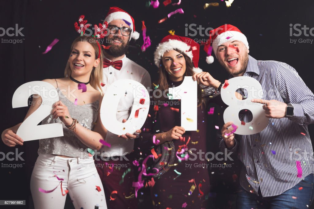 Two beautiful young couples having fun at New Year\'s Eve Party,...