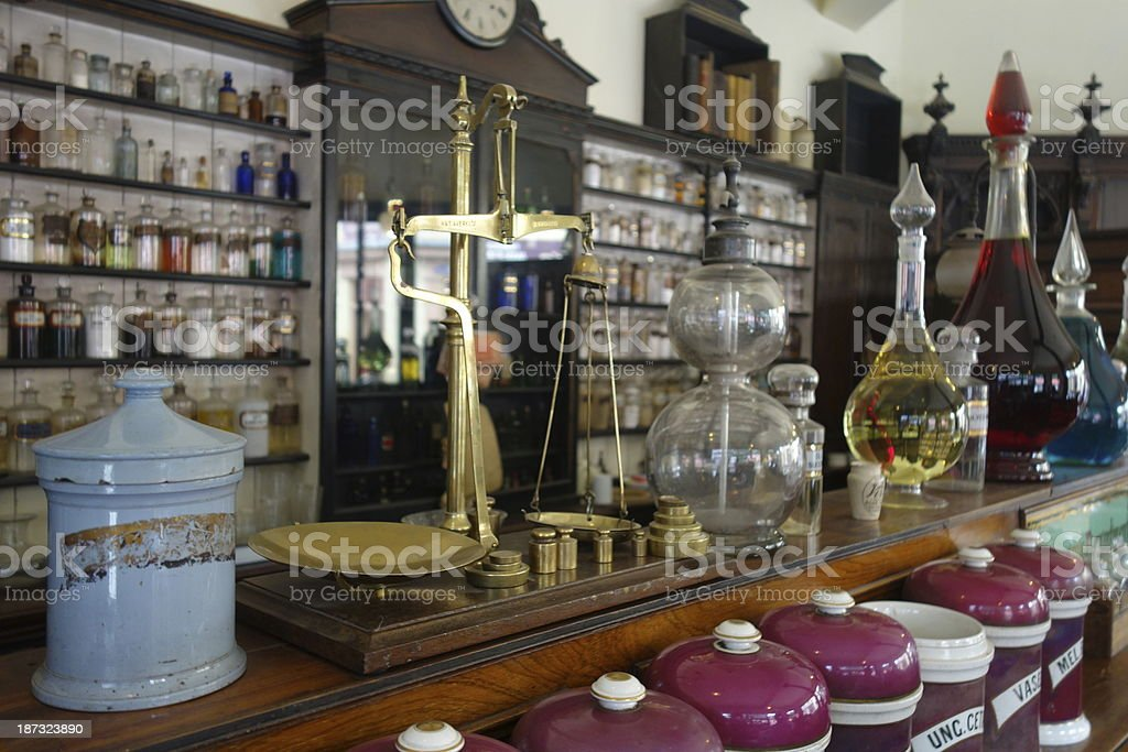 Counter of old chemist with scales and glass bottles stock photo