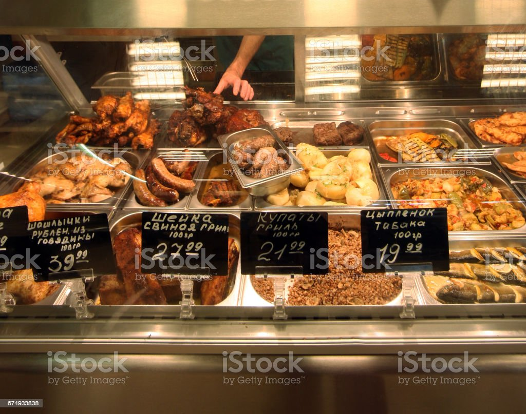 Counter with meat products and the prices stock photo