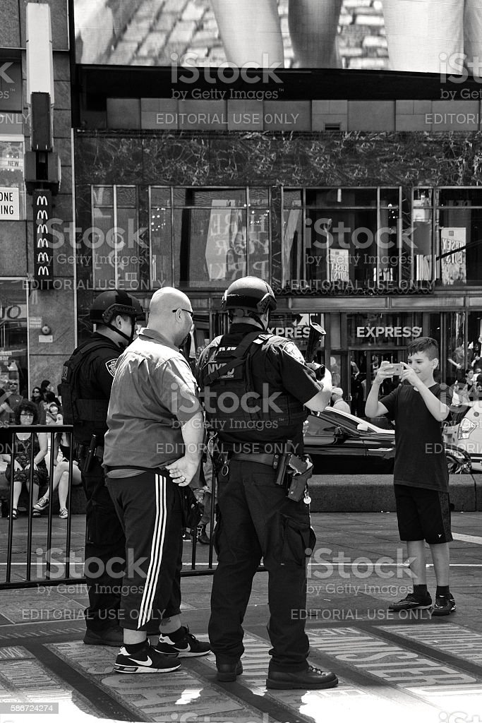 NYPD Counter-Terrorism Officers Posing With Tourists, Times Square, Manhattan, NYC stock photo