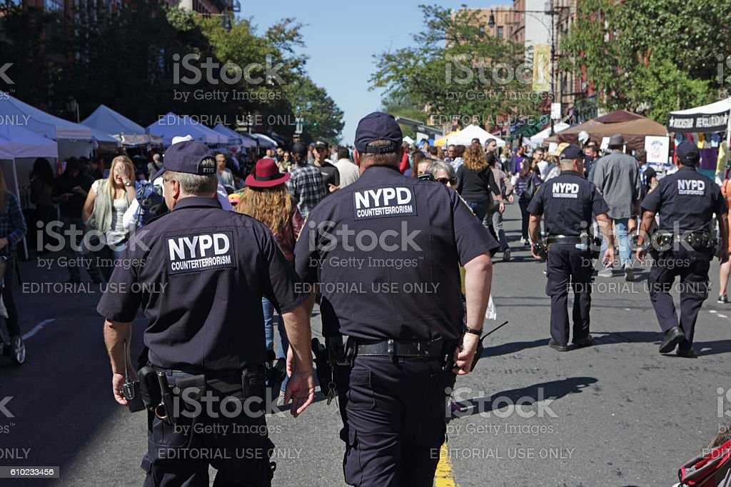 NYPD Counterterrosism officers patrol the Atlantic Antic street fair Brooklyn stock photo