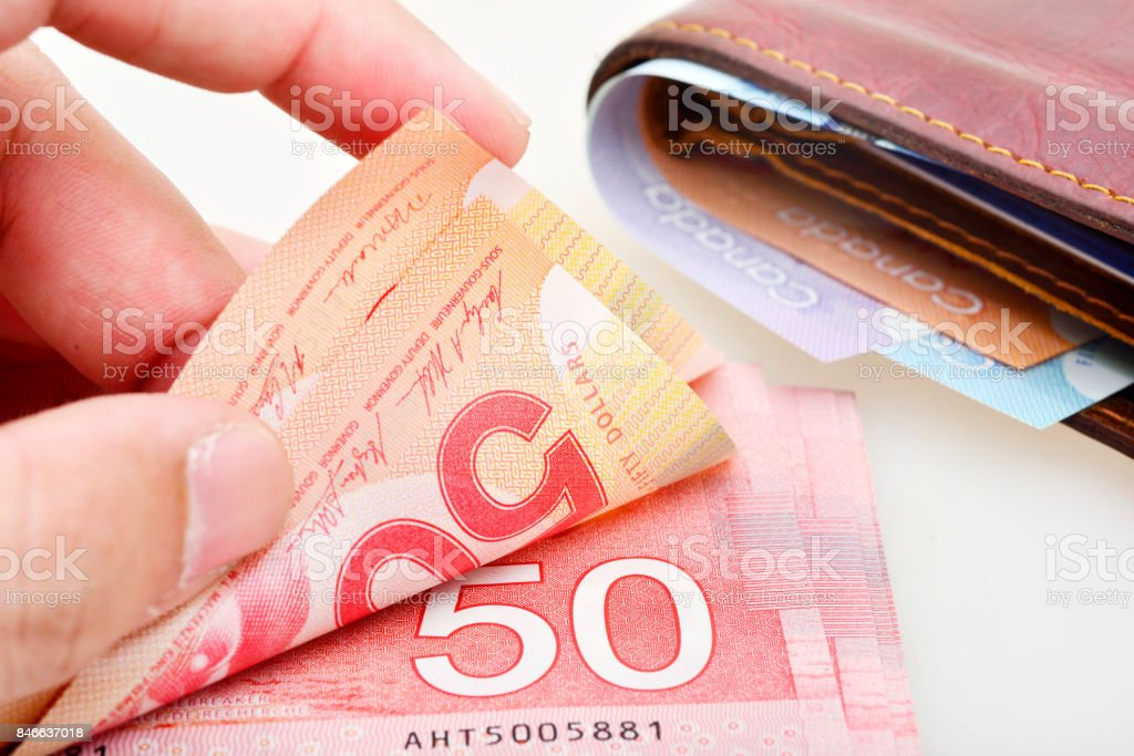 Counting Canadian banknotes stock photo