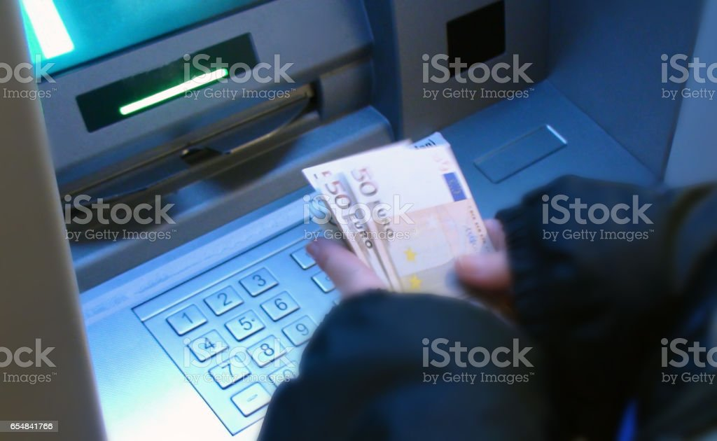 Counting Euro Currency After Withdrawing From Cash Machine stock photo