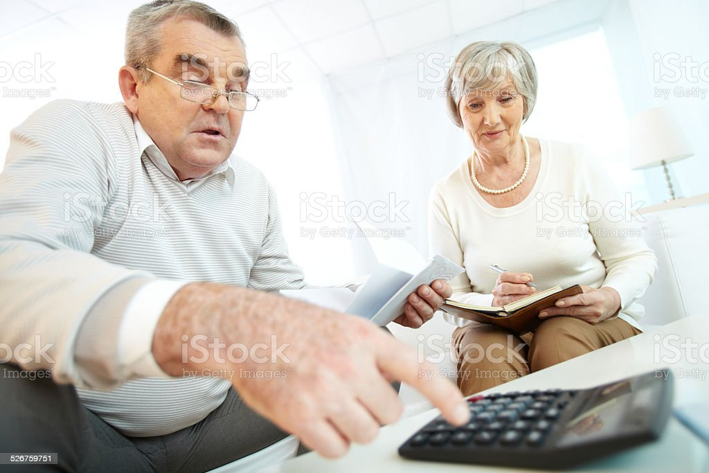 Counting expenses stock photo