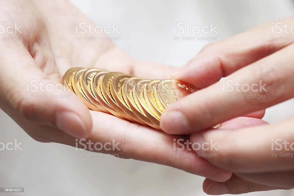 Counting Gold Coins royalty-free stock photo