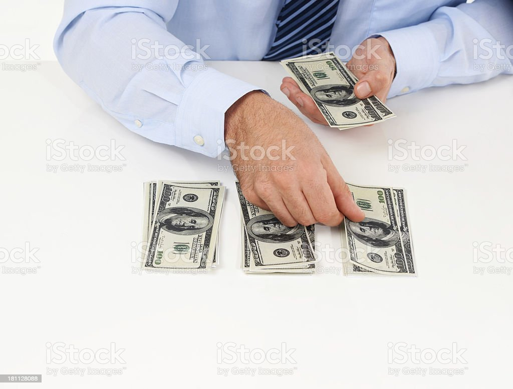 Counting his cash royalty-free stock photo