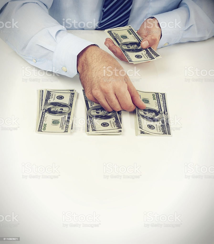 Counting his cash stock photo