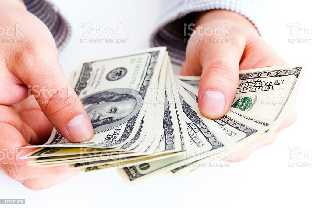 Counting hundred dollar bills royalty-free stock photo