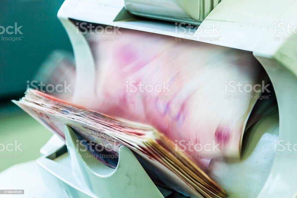 counting money machine stock photo