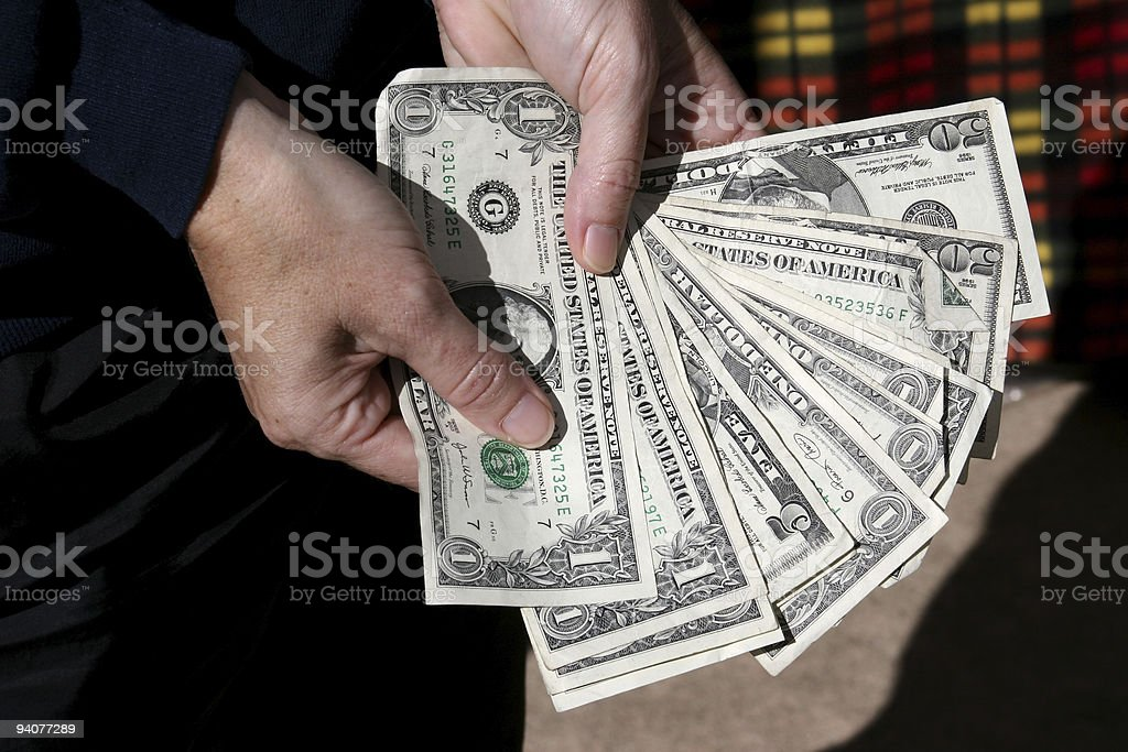 Counting money. One dollar bills, 50s. Holding. stock photo