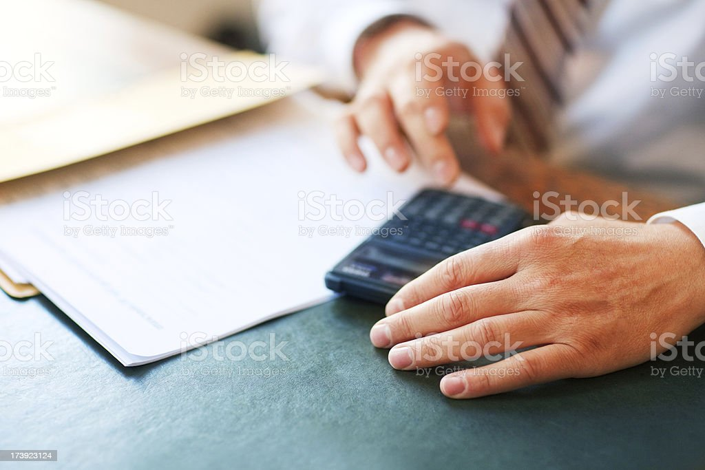 Counting on calculator royalty-free stock photo