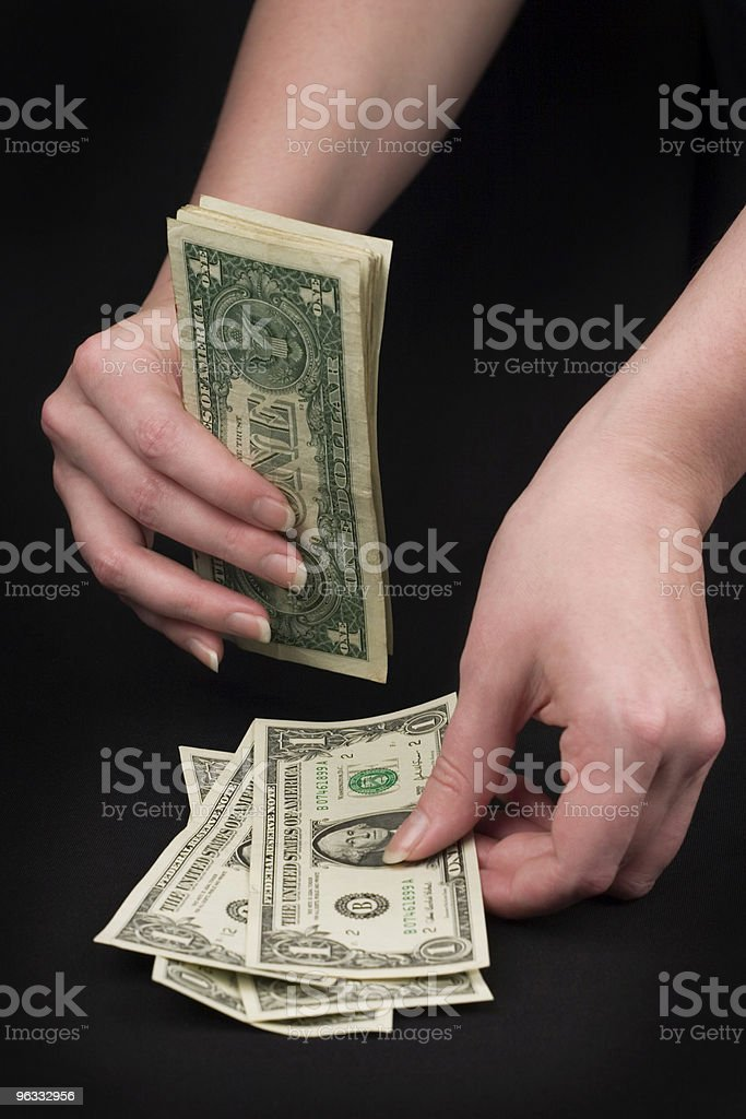 Counting Out the Cash royalty-free stock photo