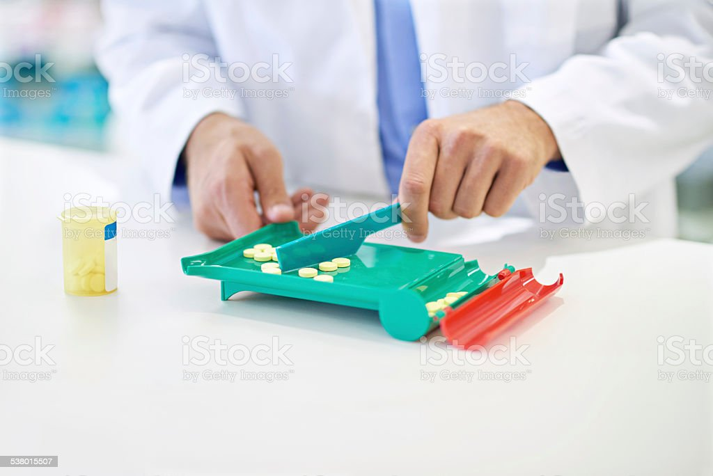 Counting out the right amount for the prescription stock photo