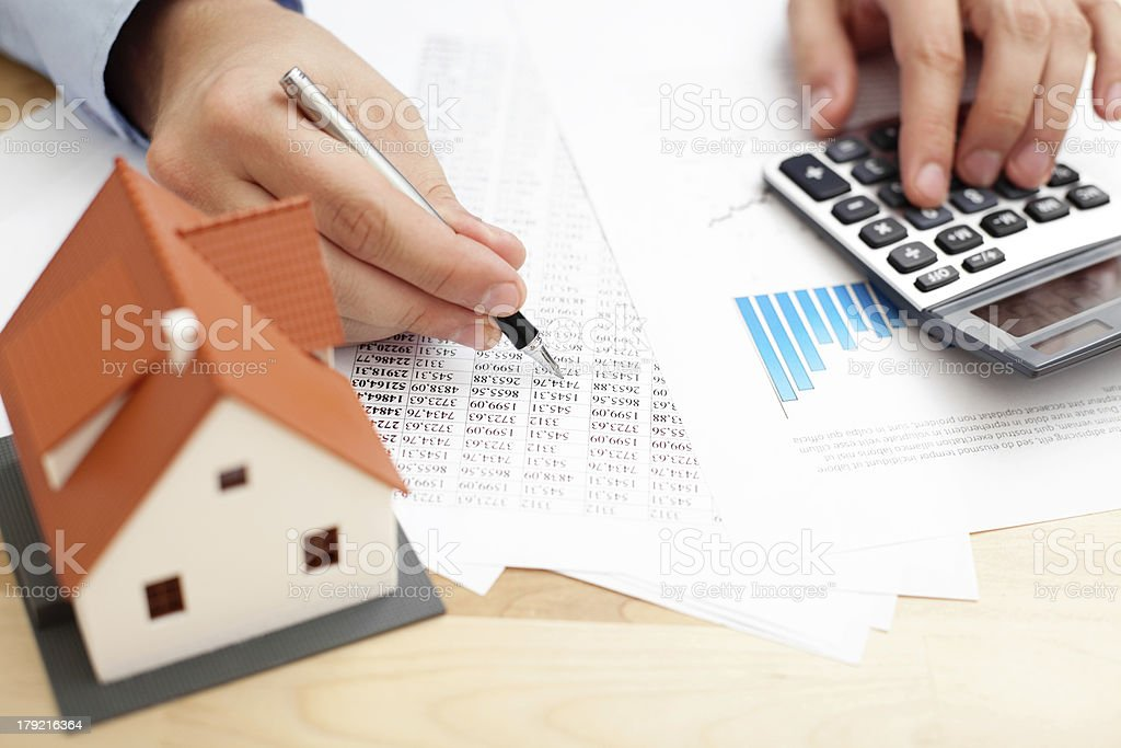 Counting payments for home stock photo