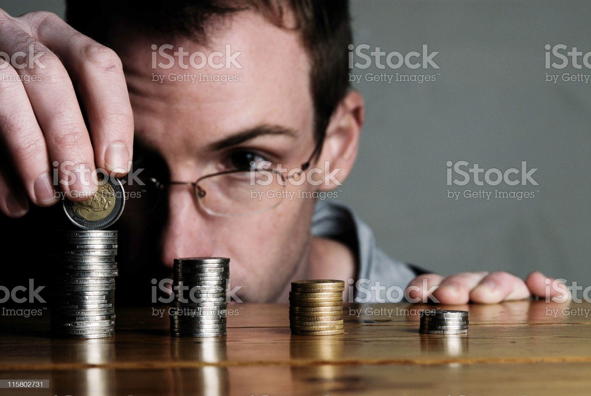Counting pennies royalty-free stock photo
