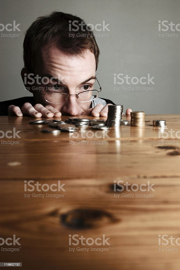 Counting pennies stock photo