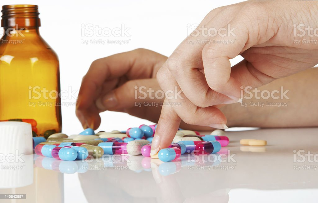 Counting pills royalty-free stock photo