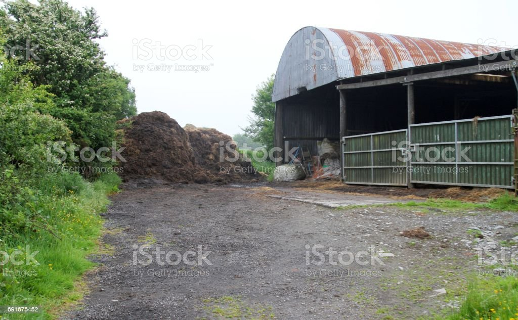country barn in lane stock photo