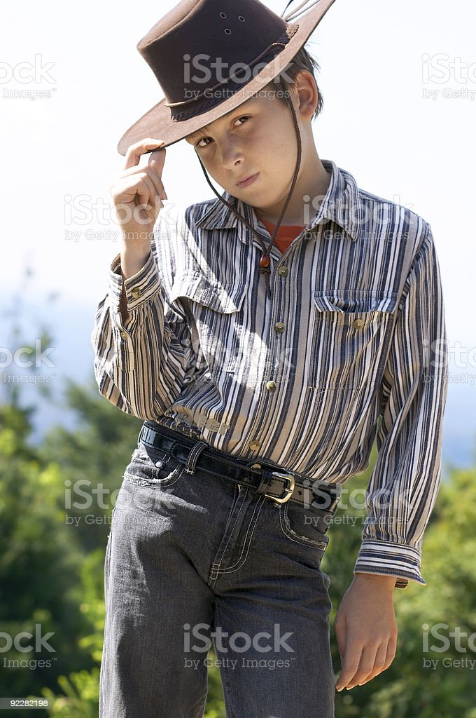 Country boy tipping his hat stock photo