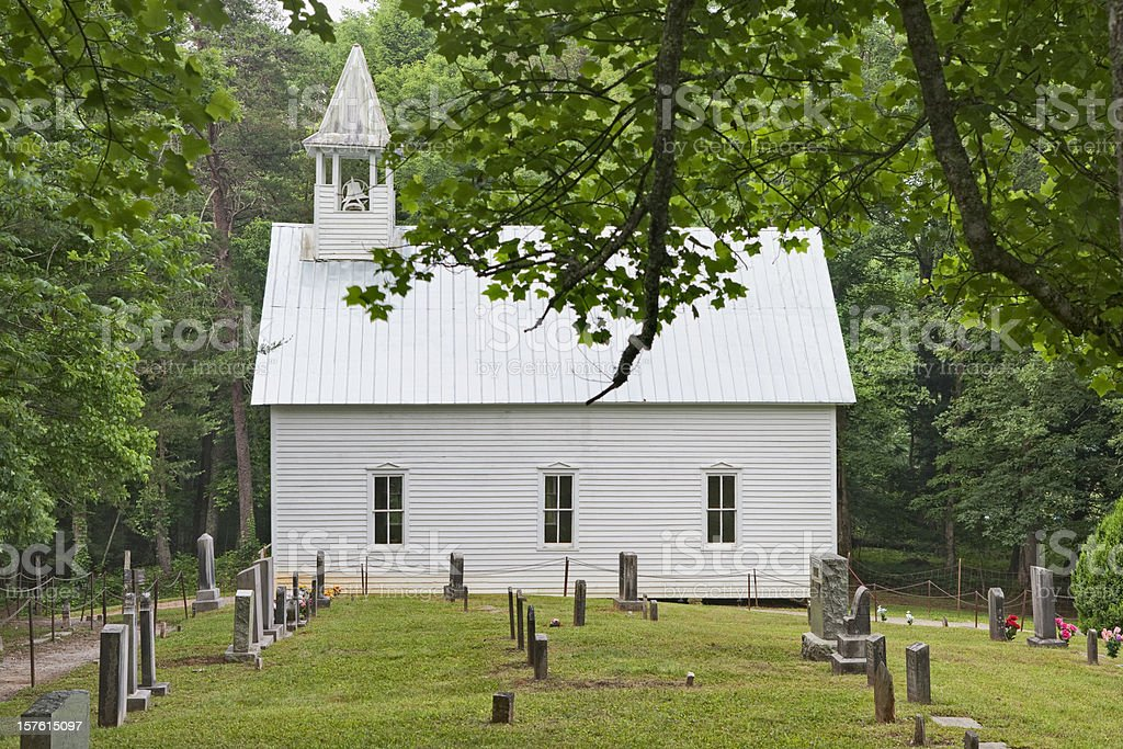 Country church with graveyard royalty-free stock photo