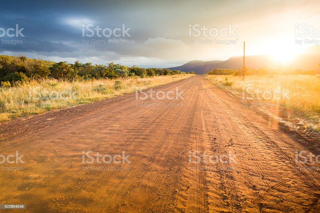 Country dirt road heading in South Africa stock photo