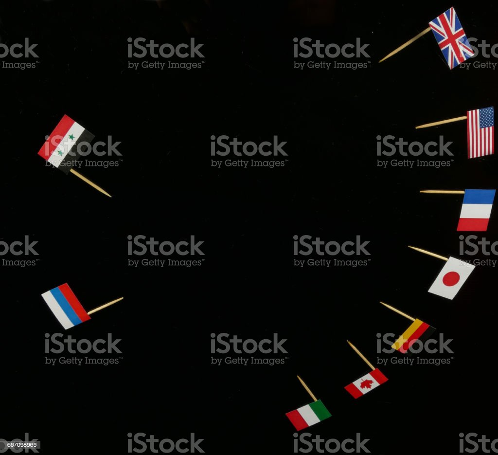 G7 Country Flags against Russian and Syrian Flags stock photo
