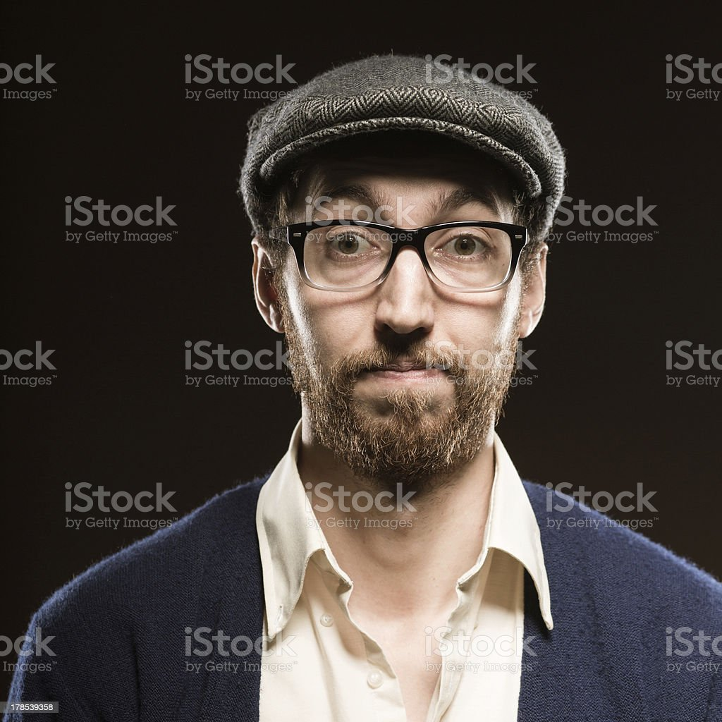 Country Gentleman in British Driving Cap with a Humorous Expression stock photo